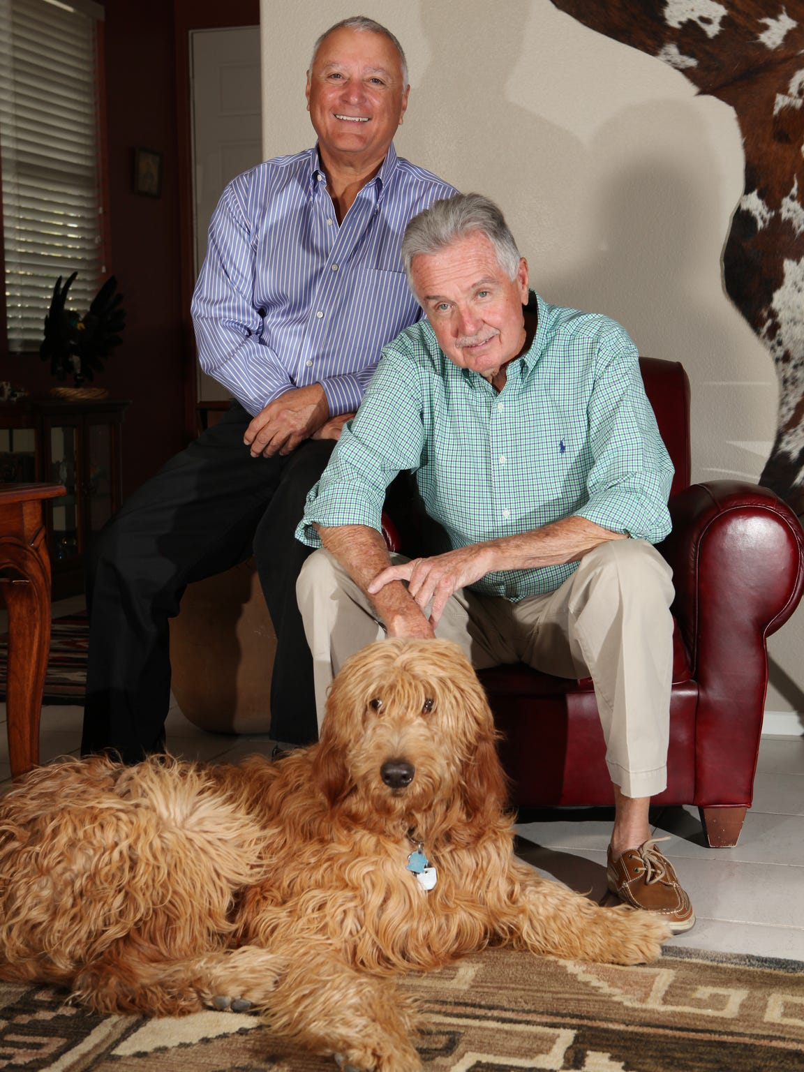 The Farago Family: (From left) Welles Farago, 68, and Marc Clausen, 74, who have been together for 42 years, with their dog Zachary on Tuesday, November 26, 2013 in Cathedral City, Calif.