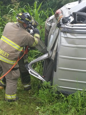 Clarksville Fire Rescue firefighters use the Jaws of Life to rescue a Clarksville man who was injured in a rollover crash Monday on Jack Miller Boulevard.