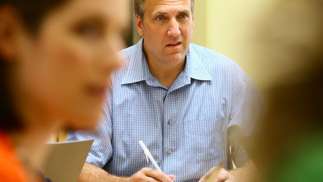 Nordic  founder and CEO Mark Bakken listens in during a meeting  in the company's Madison offices.