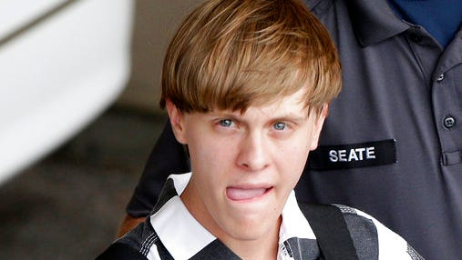 FILE - In this June 18, 2015, file photo, Charleston, S.C., shooting suspect Dylann Storm Roof is escorted from the Cleveland County Courthouse in Shelby, N.C.   Solicitor Scarlett Wilson told The Associated Press on Friday, March 31, 2017,  that Roof is scheduled to enter a guilty plea during a hearing on April 10 in Charleston. The plea on all of his state charges, including nine counts of murder, comes in exchange for a sentence of life in prison, the prosecutor said. Roof has been awaiting trial on state murder charges for the deaths of nine black parishioners at Charleston's Emanuel AME Church in June 2015.