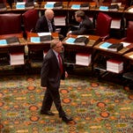 Sen. John DeFrancisco, R-Syracuse, walks in the Senate Chamber at the Capitol on Monday, May 4, 2015, in Albany, N.Y. (AP Photo/Mike Groll)