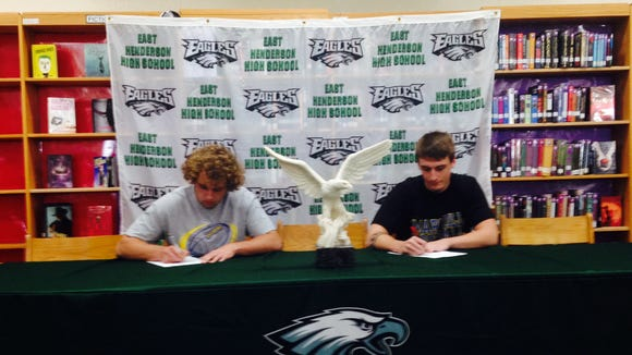 East Henderson seniors Trace Goldsmith, left, and Jay Spencer have signed to play college football for Mars Hill.