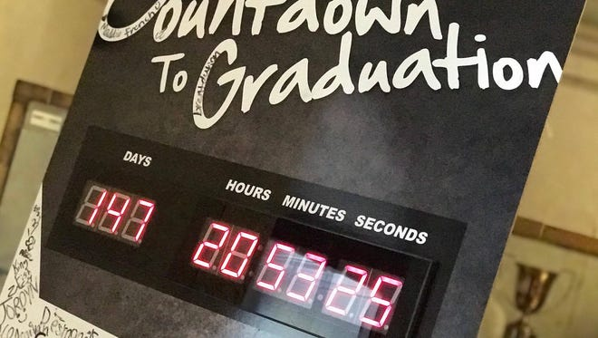 A sign at Bolton High School counts down to graduation day. The Alexandria high school is hoping to improve graduation rates by addressing truancy.