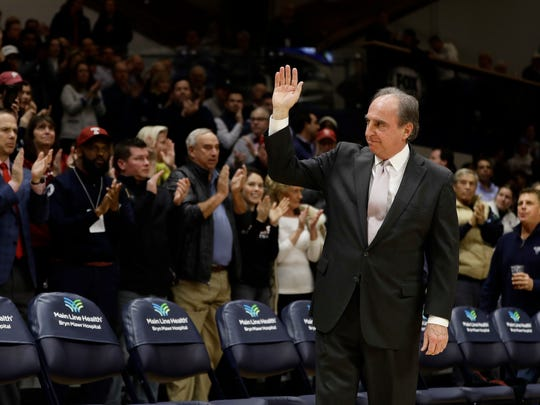 Temple head coach Fran Dunphy acknowledges the crowd before a game against Villanova on Dec. 5. Dunphy is retiring at the end of the season.