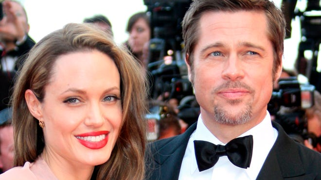 Brad Pitt and Angelina Jolie arrive for the screening of the film 'Inglourious Basterds' in Cannes, France, in May 2009.