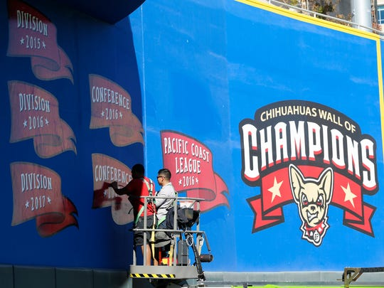 As Chihuahuas Vice President and General Manager Brad Taylor and MountainStar Sports Group President Alan Ledford were announcing Wednesday that the team will play an exhibition game at 6:35 p.m. March 26 at Southwest University Park, crews from Big Media were placing the 2017 pennant on the Wall of Champions inside Southwest University Park. The game will kick off the Chihuahuas' Fifth Season Celebration festivities. Wednesday's announcement included the official debut of the Fifth Season Celebration logo that will be used throughout the 2018 season and the addition of the 2017 division and conference championship flags on the Wall of Champions in the outfield of Southwest University Park.