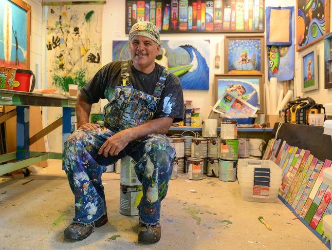 Painter John Donato sits in his studio in Ocean View,