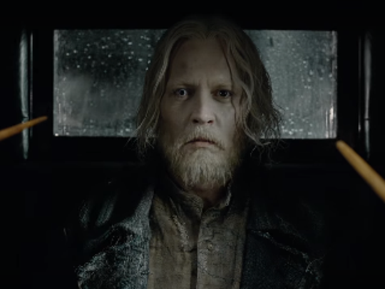 Johnny Depp's Grindelwald is held by wands in the 'Fantastic