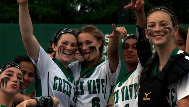 Green Wave players celebrate a win against Naples in the 7A softball regional quarterfinals at Fort Myers High on Wednesday, April 20, 2016. (J. Scott Butherus/Staff)