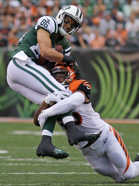 Cincinnati Bengals outside linebacker Vontaze Burfict tackles New York Jets wide receiver David Nelson (86) in the first half of an NFL preseason football game, Saturday, Aug. 16, 2014, in Cincinnati. (AP Photo/Tony Tribble)