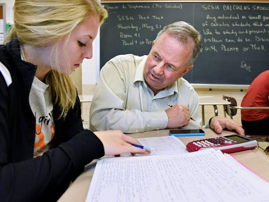 Technical High School math teacher Robert Boatz helps