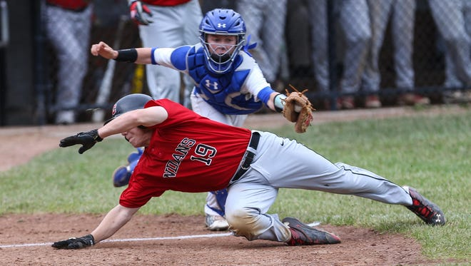 Simon Kenton catcher Hunter Faehr tags out Holy Cross' Joey Yancey for the second out of the sixth inning Thursday.