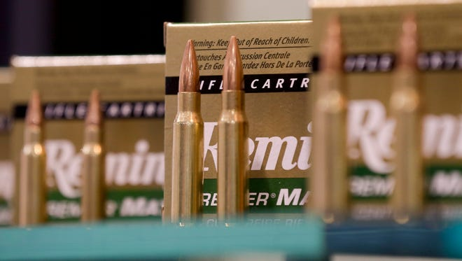 Remington rifle cartridges are displayed at the 35th annual SHOT Show in Las Vegas. Remington, the gunmaker beset by falling sales and lawsuits tied to the Sandy Hook Elementary School massacre, said Monday, Feb. 12, 2018, that it has reached a financing deal that would allow it to continue operating as it files for Chapter 11 bankruptcy protection.