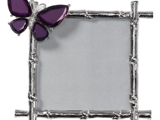 A beveled glass butterfly alights on silvered bamboo to make an elegant picture frame from Z Gallerie. Artists and designers have long used insects, reptiles and other small animals as inspiration.