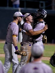 Harley Patterson hugs catcher Billy Book after Patterson escaped a two-on, two-out jam in the bottom of the seventh inning of Unioto's 2-1 win against Sheridan on Monday in a Division II district semifinal at Ohio University's Bob Wren Stadium.