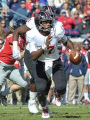UL quarterback Levi Lewis scrambles against Ole Miss last season.