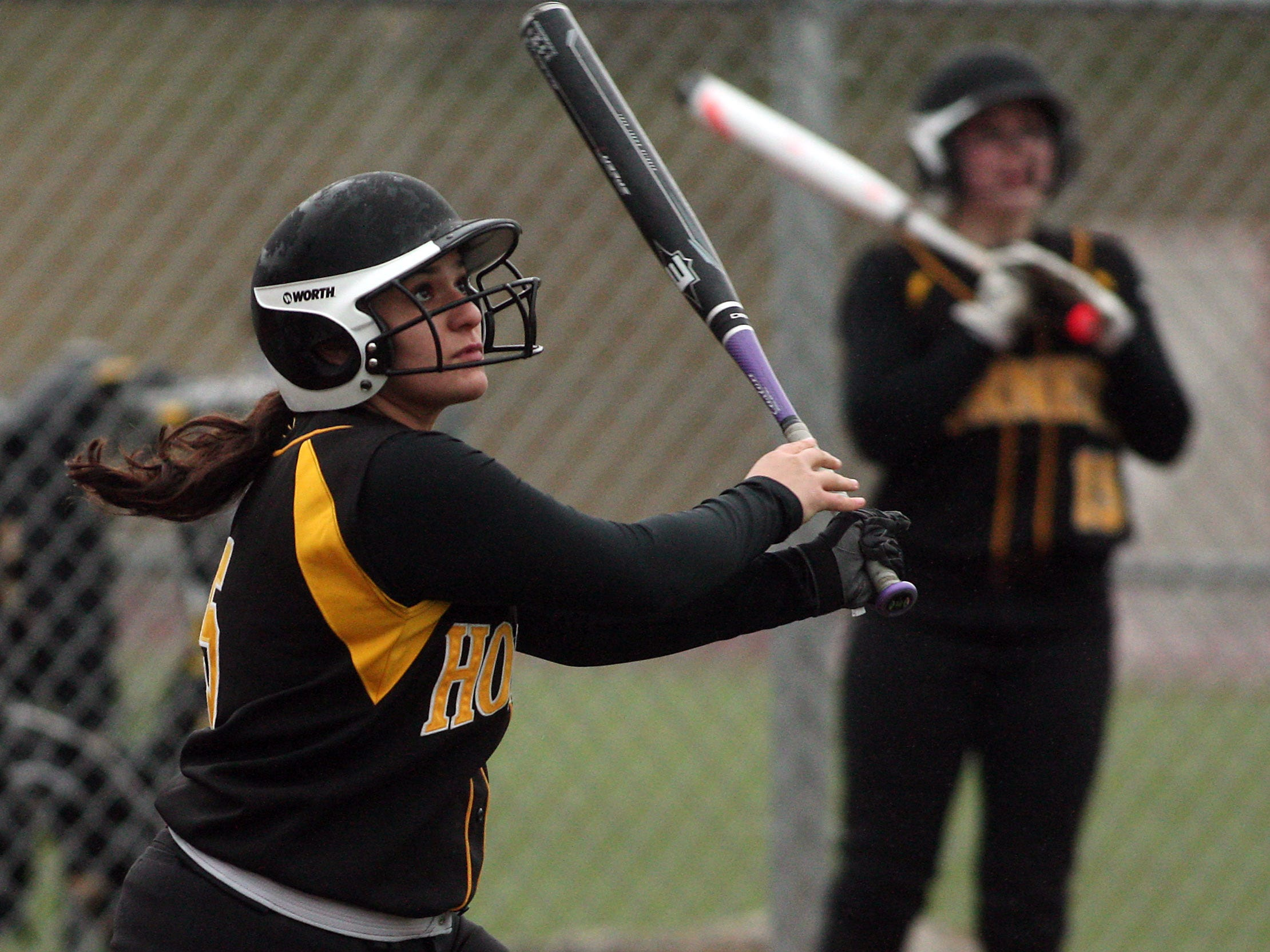 Hanover Park's Alex Cosenzo watches her three-run home run clear the right field fence at Morristown Beard. The homer would prove the game winner as Hornets won 9-5 in nine innings