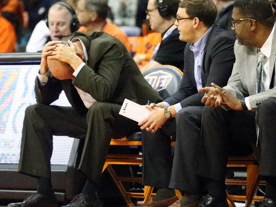 UTEP interim head coach Phil Johnson, left, could't