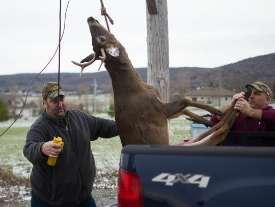 Chad Hale, left, owner of Back Country Sports in St.