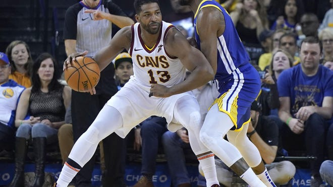 Cleveland Cavaliers center Tristan Thompson (13) moves the ball against Golden State Warriors forward Kevin Durant (35) during the first half of an NBA basketball game Friday, April 5, 2019, in Oakland, Calif.