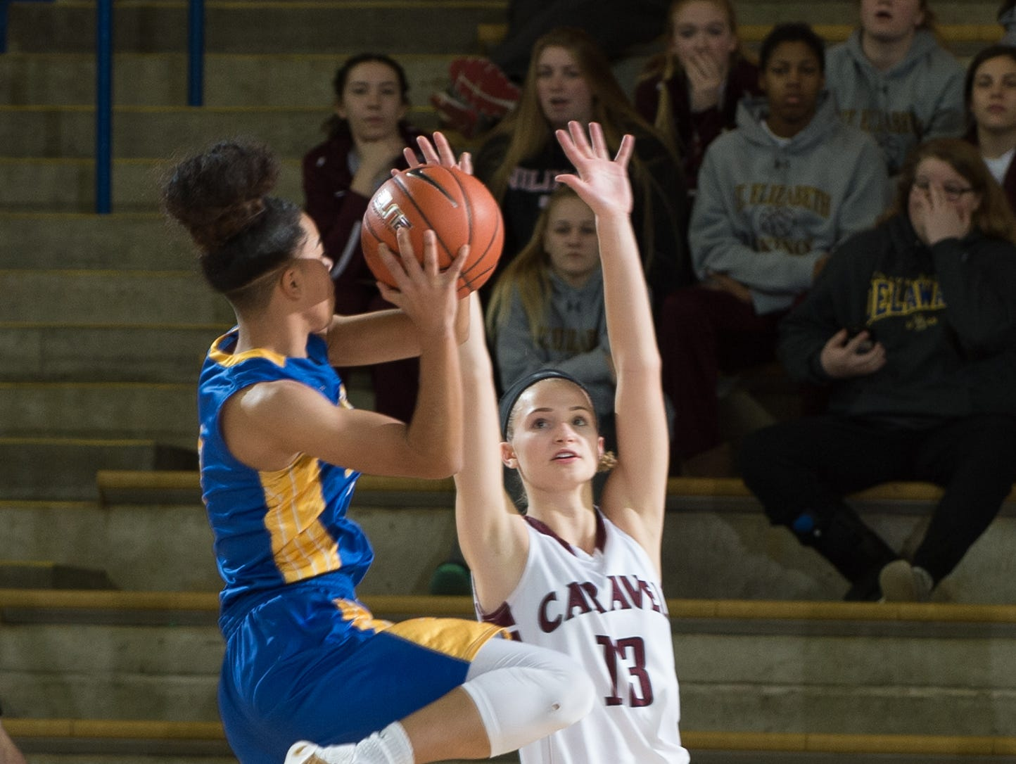 A.I. duPont's Lauryn Griffin (2) jumps up for a shot over Caravel's Grace Lange (13) during the first period of their game in the quarterfinals of DIAA Girls Basketball Tournament at the University of Delaware.