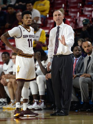 Arizona State Sun Devils head coach Bobby Hurley talks with guard Shannon Evans II (11) during the first half against the Central Arkansas Bears at Wells-Fargo Arena.