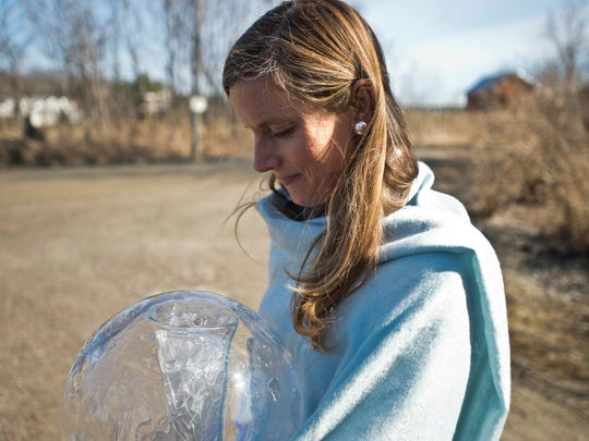 For the first time, Shyla Nelson holds her globe with shards of an old shattered globe inside, housed in a glass cylinder. The two had never been joined before. The original globe traveled with Nelson around the planet, as she advocated for environmental protection.