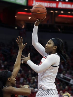 Louisville's Myisha Hines-Allen floats up a shot for two.