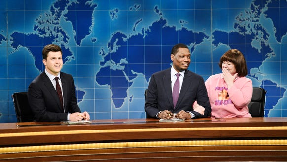 Colin Jost (from left) and Michael Che with Melissa