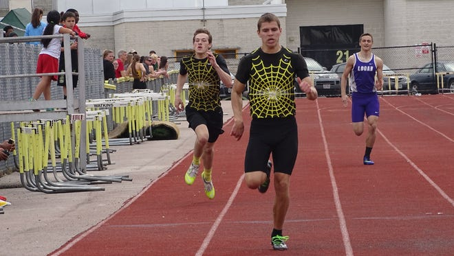 Watkins Memorial's Matt Eader, center, nears the finish line in the 400 while teammate Andrew Cornelius follows this past Saturday during the Watkins Icebreaker.