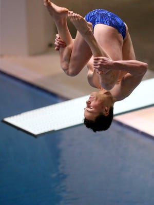 South Kitsap's Jason Gleason executes an inward double somersault for his final dive during the 4A Swim/ Dive Championships at King County Aquatic Center in Federal Way on Saturday, Feb. 18, 2017. Gleason took first place with a score of 474.20.