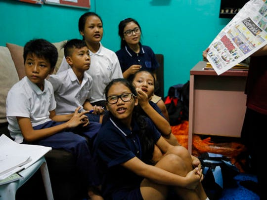 In this March 11, 2017, photo, Christian Burmese refugee students listen to a volunteer teacher during an English lesson in Kuala Lumpur, Malaysia. An Associated Press analysis suggests that the people hurt most by President Donald Trump's planned deep cuts in refugee visas are from not any of the six Muslim countries listed in his travel ban, but Myanmar.