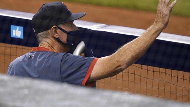 Boston Red Sox interim manager Ron Roenicke gestures from the dugout during a baseball game against the Miami Marlins, Tuesday, Sept. 15, 2020, in Miami.