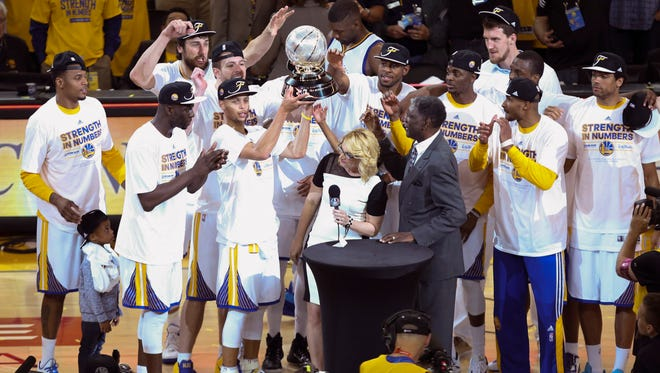 Golden State Warriors players celebrate the western conference championship.