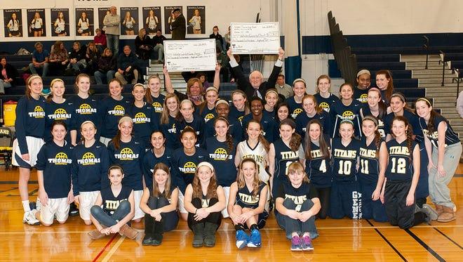 Webster girls basketball team with checks.
