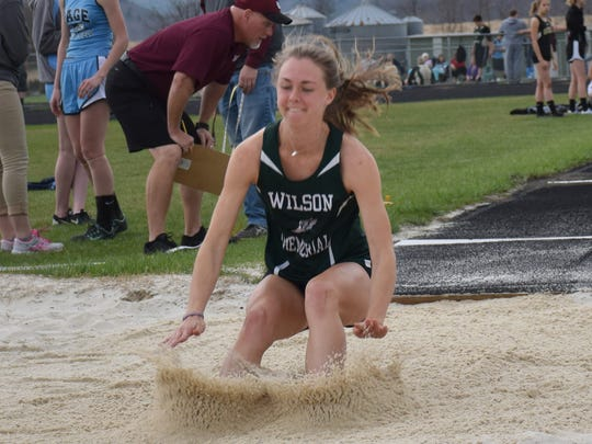 Wilson Memorial's Emilie Miller lands in the pit during the girls long jump competition in a Shenandoah District meet at East Rockingham High School in Elkton, Va., on Wednesday, April 5, 2017.