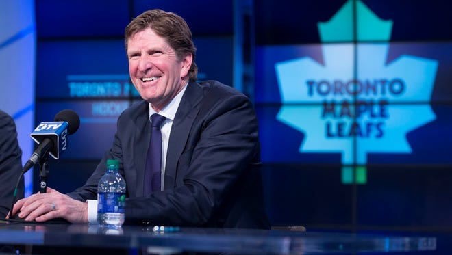 Toronto Maple Leafs head coach Mike Babcock laughs during a news conference in Toronto on May 21, 2015.