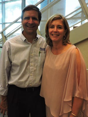 """Dave Guizerix and Cathy Connelly enjoy the """"Be a Tourist in Stuart"""" kickoff event at the Elliott Museum."""