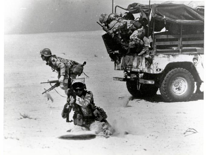 A gun team from Battery B, 1st Battalion, 320th Field