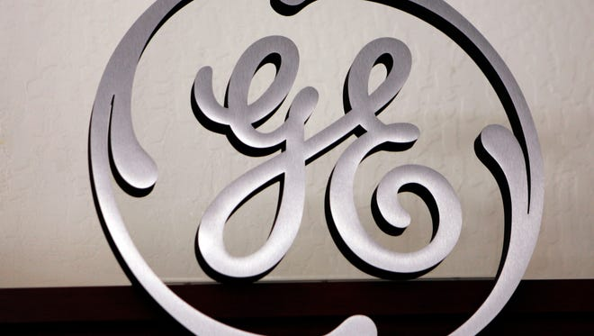 In this Dec. 2, 2008 file photo, a General Electric sign is displayed at a Western Appliance store in Mountain View, Calif.
