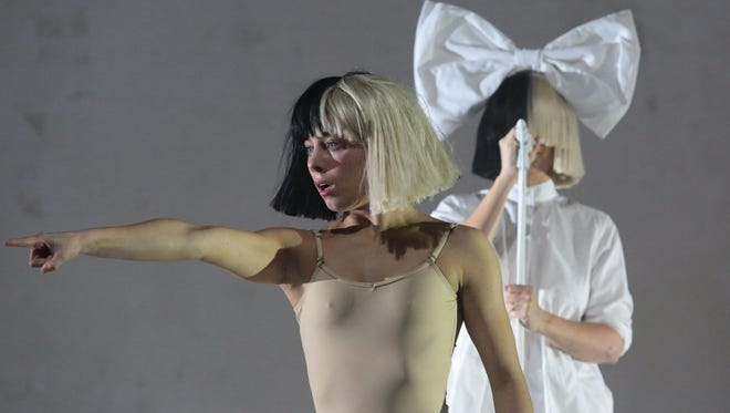 Sia performs on the Coachella Stage during the first Sunday of the Coachella Valley Music and Arts Festival on April 17, 2016 in Indio.