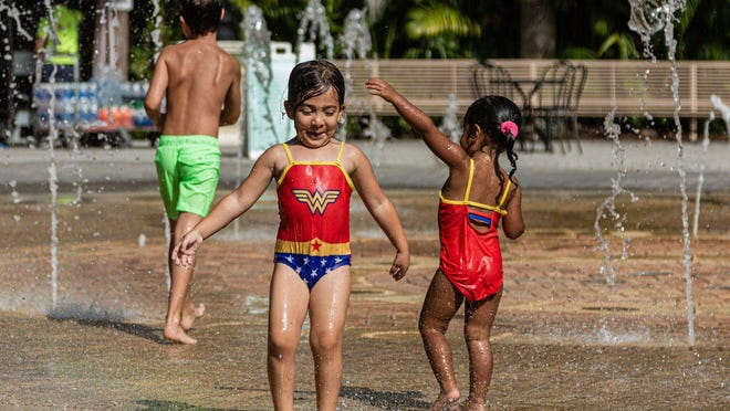 Children at play in the Fountain Plaza splash pad at Dreher Park Zoo in West Palm Beach.
