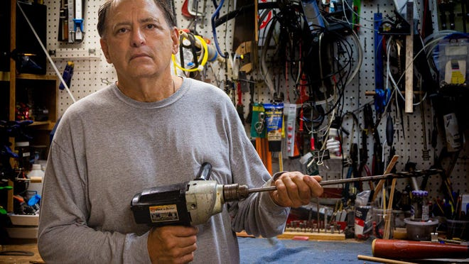 Bryan Greenberg in his Jupiter garage with the power drill he said he used in 1984 to cork baseball bats for Pete Rose.