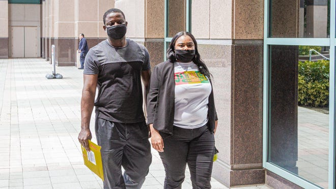 Late Gean of West Palm Beach, left, and Cassandra Jackson of Miami leave the Palm Beach County Courthouse in West Palm Beach, Wednesday, June 24, 2020. Palm Beach County commissioners unanimously agreed that masks must be worn in all buildings where the public is welcome to help fight the spread of coronavirus.