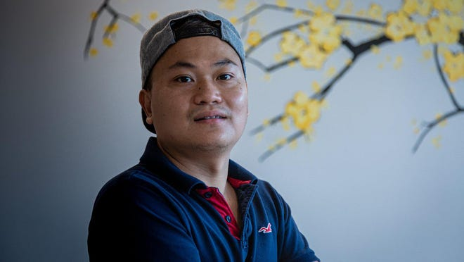 """Phillip Cao, 32, runs the family owned restaurant Pho & Rolls, which opened in May in the Pennock Square shopping center on Indiantown Road in Jupiter. """"I always had a dream of opening a restaurant in America,"""" Cao said."""