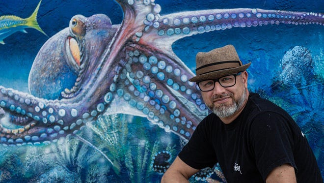 Artist Sami Makela in front of Tuppen's Marine and Tackle in Lake Worth Beach, Thursday, August 13, 2020. Makela has painted a large wrap around mural on the exterior walls of Tuppen's.