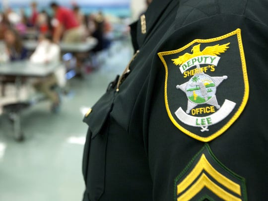 Lee sheriff's Cpl. Chris Stevens stands guard in 2013 at North Fort Myers Academy of the Arts. The News-Press file