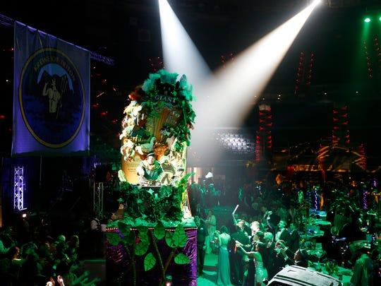 The Krewe of Triton celebrates Mardi Gras with a ball in the Cajundome Saturday night Feb. 25, 2017.