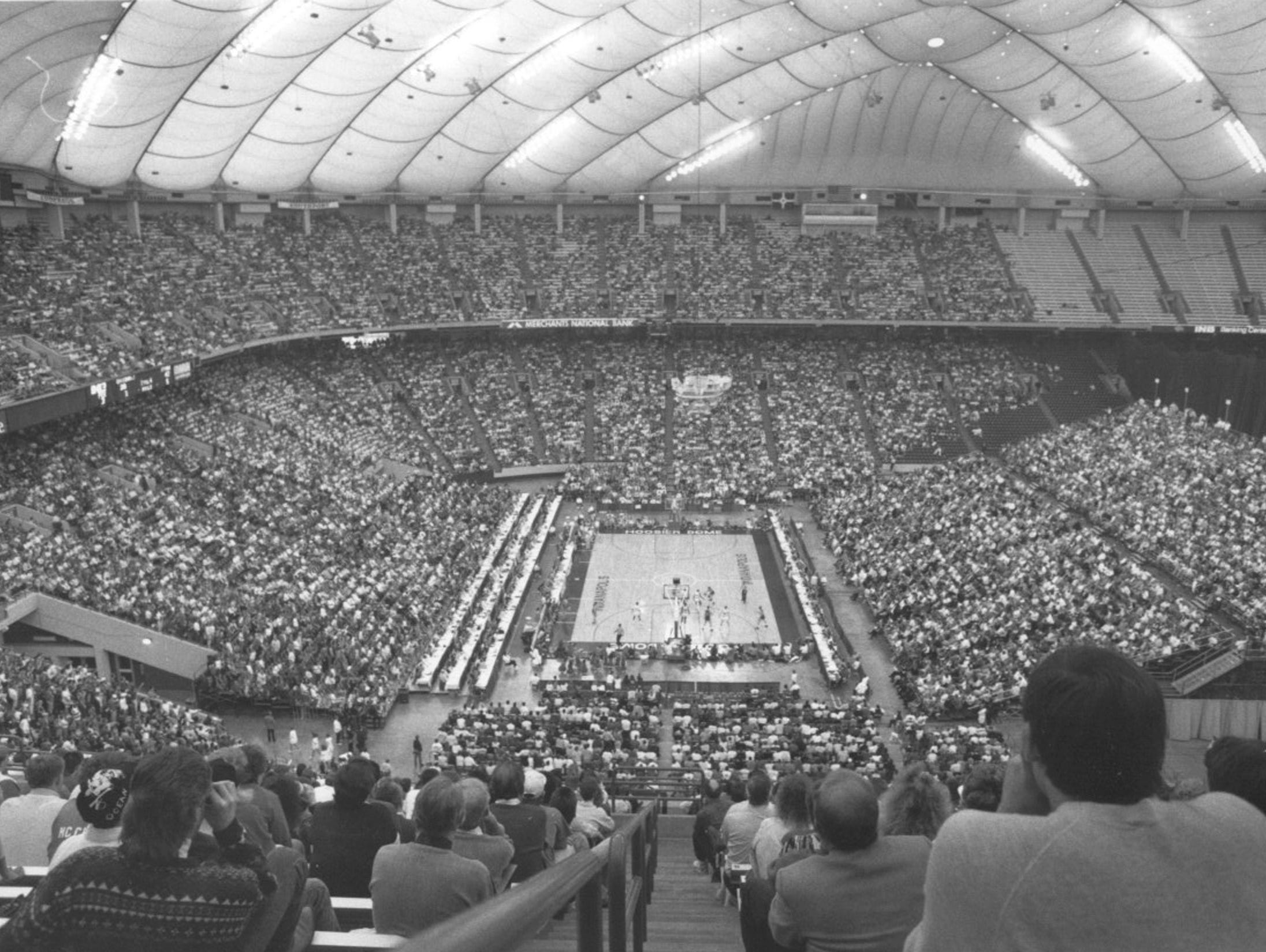 The 1990 IHSAA basketball finals moved to the then-Hoosier Dome. A national-record high school crowd of 41,046 was in attendance. The final game was Bedford North Lawrence (Damon Bailey) vs. Concord.