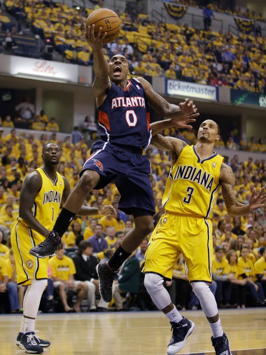 Atlanta Hawks' Jeff Teague shoots against Indiana Pacers' George Hill during the first half in Game 1 of an opening-round NBA basketball playoff series on Saturday, April 19, 2014, in Indianapolis. (AP Photo/Darron Cummings)